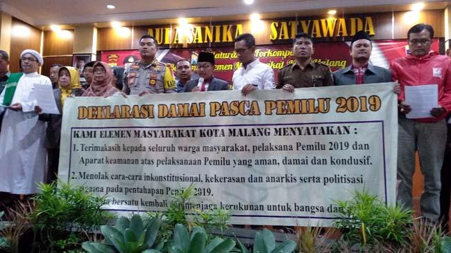 Pembacaan Deklarasi Damai pasca Pemilu 2019 di Mapolres Malang Kota. (ist)