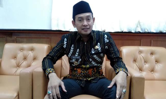 RANGKAP : Wakil Bupati Sampang sekaligus Ketua BNK Sampang H Abdullah Hidayat. (zyn)
