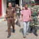 Tersangka pemalsuan akte tanah, Irwan Yudhiyanto (baju garis merah putih) saat diamankan oleh pihak Kejari dan TNI, di kantornya yang terletak di Jalan Pemuda Kaffa, Bangkalan. Kamis (17/10/2019)
