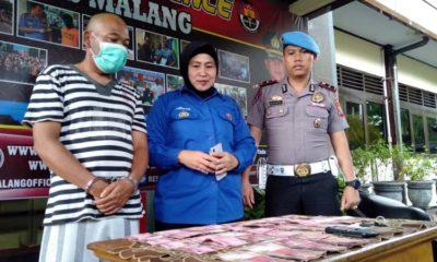 Kades Ngadireso berbaju tahanan di Polres Malang. (Ist)