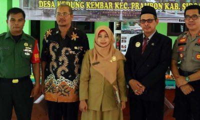 Kepala Desa Kedungkembar, Achmad Jupriyanto dan Forkopimka Prambon bersama Kasun Sigit, Ari Maulina.(par)