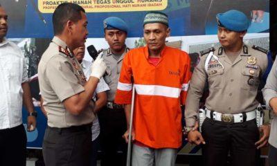 Tersangka Yan saat dirilis pada pers oleh Kapolresta Malang Kota AKBP Dr Leonardus Harapantua Simarmata Permata S Sos SIK MH. (gie)