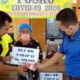 CAIR : Kepala Desa Paowan Saiful Hady S Pd dan didampingi Kaur Desa Mohammad Faisol S Pd bersama Babhinkamtibmas dari Polsek Panarukan saat memberikan bantuan secara simbolis bantuan BLT - DD tahap II tahun anggaran 2020. (her/im)