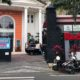 Tampak depan logo RedDoorz terpampang jelas di depan gerbang SMK 4 Malang